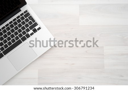 Laptop computer on a wooden desk, top view copy space - stock photo