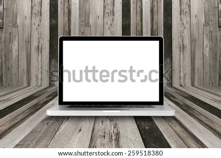 laptop computer on wood table with clipping path on Screen - stock photo