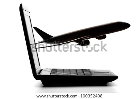 Laptop computer with airliner flying out from screen on a white background - stock photo
