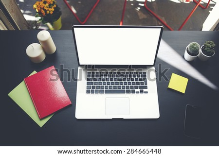 Laptop computer with blank copy space screen for your information or content, on-line learning or distance work concept,freelance workplace with empty display notebook on modern table in home interior - stock photo