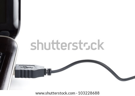 laptop computer with USB cable on white background - stock photo