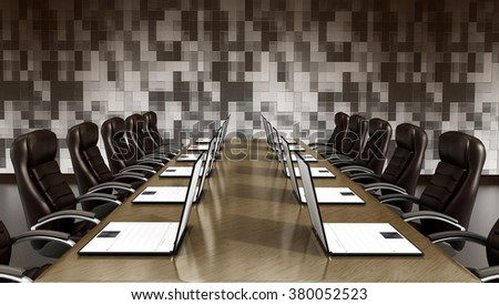 Laptop computers standing on wooden boardroom table