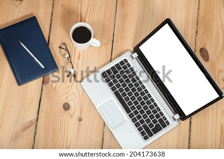 laptop, cup of coffe and notebook on wooden floor - stock photo