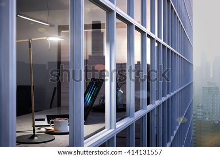 laptop, cup on table in office through the window glass conceptual background