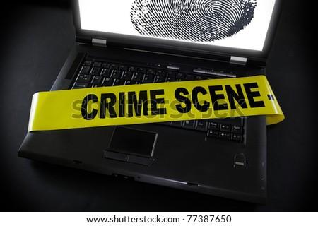 laptop fingerprint with crime scene tape across it - stock photo