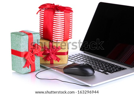 Laptop, gifts and computer mouse isolated on white - stock photo