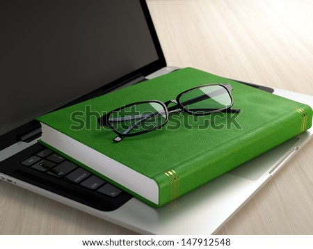 Laptop, green book and glasses on wooden desk. Electronic education concept. - stock photo