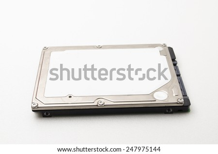 Laptop hard disk drive, the tag and information about the hard disk was removed. Focus on the closes distance. - stock photo