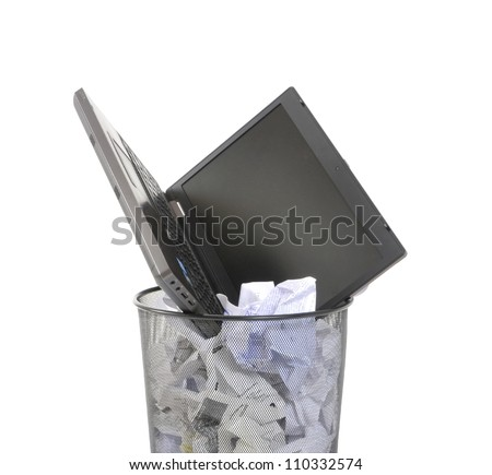 Laptop in a trash bin on a white background - stock photo