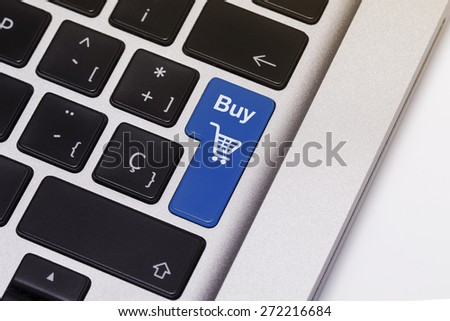 """Laptop key showing the word """"buy"""", in blue color. - stock photo"""