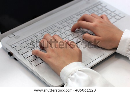 laptop keyboard and hands