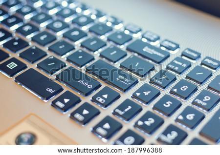laptop keyboard enter light - stock photo