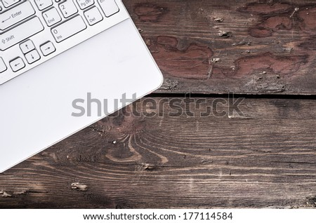 laptop keyboard on rustic wooden table