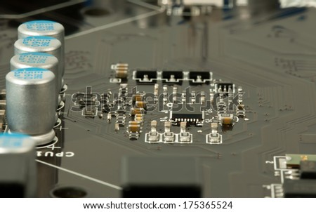 Laptop microchip and conductors on mother board closeup - stock photo