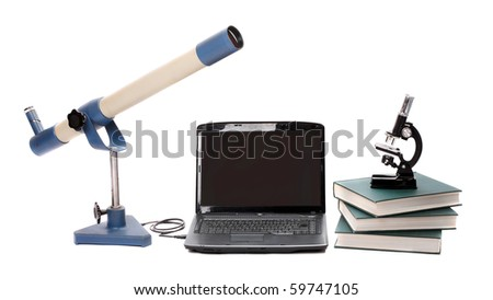 Laptop, microscope, books, telescope and others tools for university education - stock photo