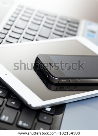 Laptop, mobile and tablet on the table - stock photo