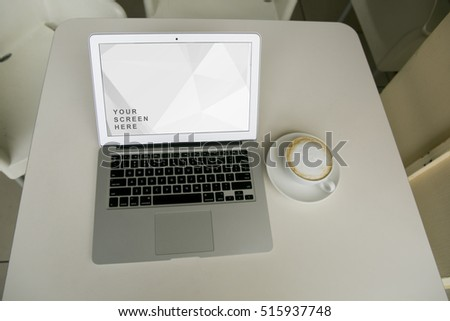 Laptop Mockup with a cup of coffee in a cafe