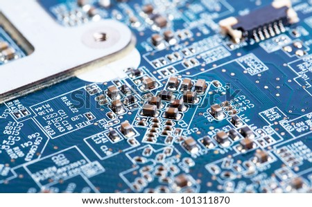 Laptop motherboard blue close view on details - stock photo