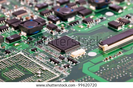 Laptop motherboard green close view on details - stock photo