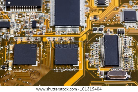 Laptop motherboard yellow close view on details - stock photo