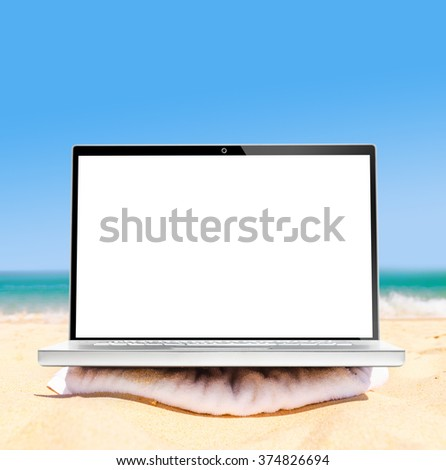 laptop on beach ready for remote work or freelance