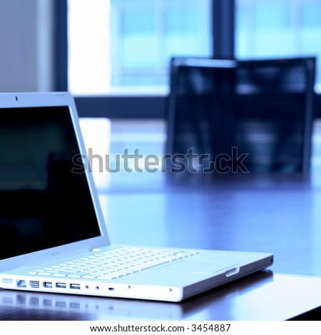 Laptop on boardroom table