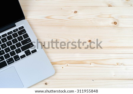 laptop on  table wood with copy space - stock photo