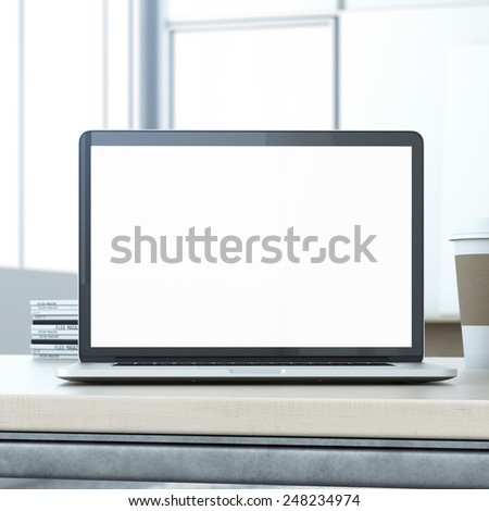 Laptop on the wooden table - stock photo
