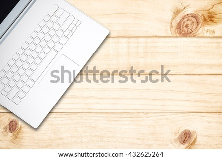 Laptop on wooden desk. Top view with copy space. - stock photo