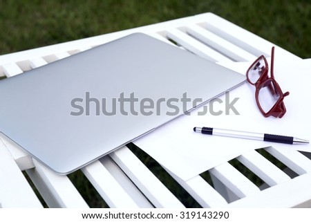 Laptop on wooden table closeup