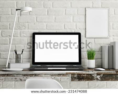Laptop on wooden table, white brick wall - stock photo