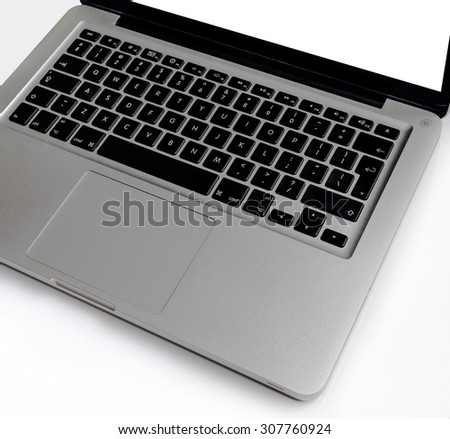 Laptop on wooden white table