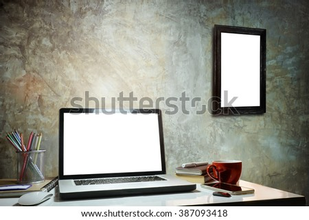 Laptop showing blank screen with coffee cup home office. - stock photo