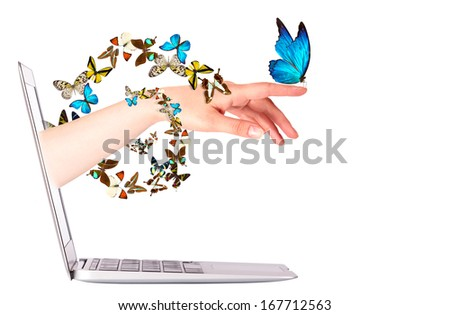 Laptop side view with  butterfly on woman's hand. In motion isolated