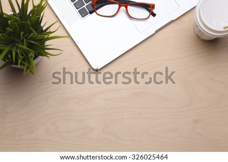 Laptop stands on a wooden table - stock photo