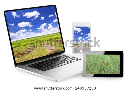 Laptop, tablet and phone with nature wallpaper on screens in collage isolated on white - stock photo