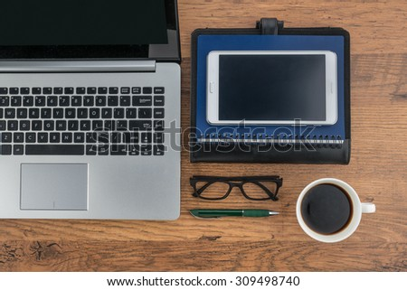 Laptop Tablet notebook and pen with a cup of coffee on the desk - stock photo