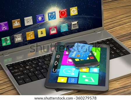 Laptop, tablet, smart phone and a bank card on wooden table. - stock photo