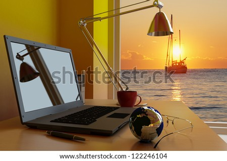Laptop to the desktop in the office. - stock photo