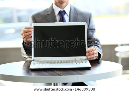 laptop with a blank screen useful for composition - stock photo