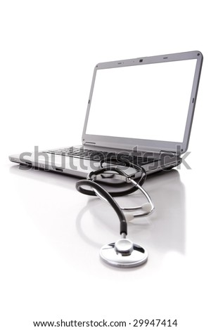 laptop with a stethoscope for good maintenance (selective focus) - stock photo