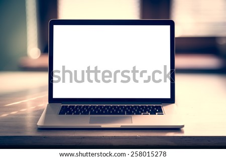 Laptop with blank screen on table - stock photo