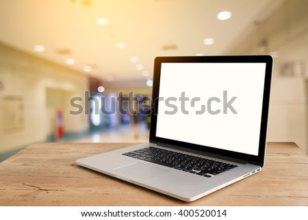 Laptop with blank screen on table.Blur background - stock photo