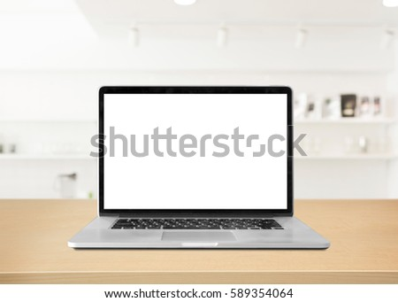 Laptop with blank screen on table. interior background, blurred background,white room