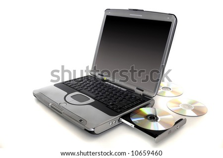laptop with CD's on a white background