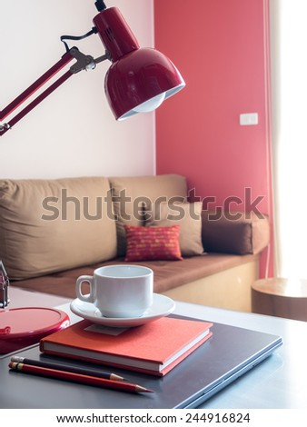 Laptop with coffee cup on desktop in modern office background - stock photo
