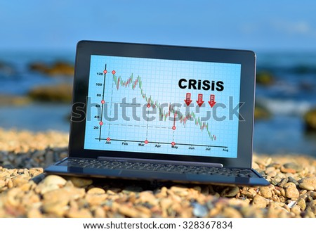 laptop with crisis chart on a ocean background - stock photo