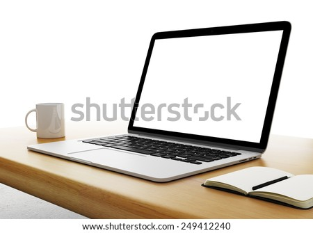 laptop with cup and diary on table - stock photo
