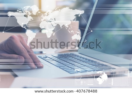 laptop with digital layer effect, globalization concept - stock photo