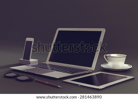 Laptop with digital tablet and smartphone - stock photo